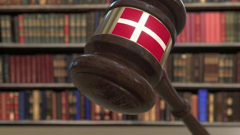 Flag of Denmark on falling judges gavel in court. National justice or Live Action