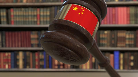 Flag of China on falling judges gavel in court. National justice or jurisdiction Live Action