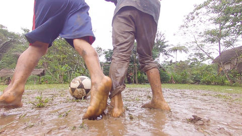 Indigenous Kids Playing Football In The Rain In An Amazon Village Live Action