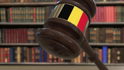 Flag of Belgium on falling judges gavel in court. National justice or Live Action