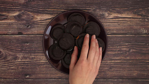 Jaffa cake on plate on wooden table - Stop motion Animation