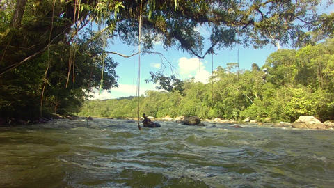 Indigenous Kids Playing With A River Inner Tube In The Amazon Rainforest Footage
