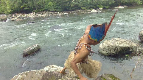 Indigenous Hunter Jumping Down On The Stones In The Amazon Jungle Footage