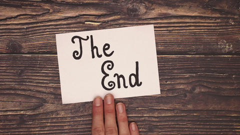 The End Sign moved by hand - Stop motion Animation