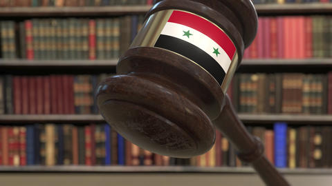 Flag of Syria on falling judges gavel in court. National justice or jurisdiction Live Action