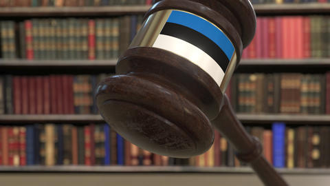 Flag of Estonia on falling judges gavel in court. National justice or Live Action