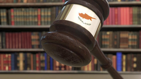 Flag of Cyprus on falling judges gavel in court. National justice or Live Action