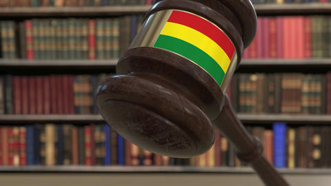 Flag of Bolivia on falling judges gavel in court. National justice or Live Action