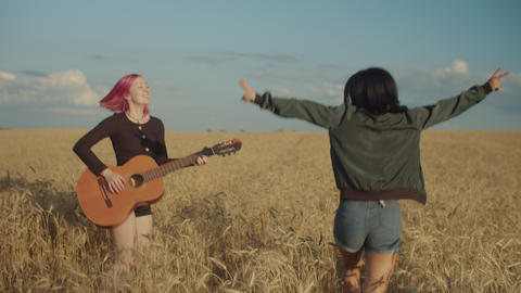 Carefree multiracial females relaxing in wheat field Footage