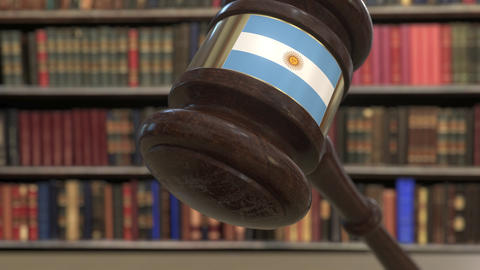 Flag of Argentina on falling judges gavel in court. National justice or Live Action