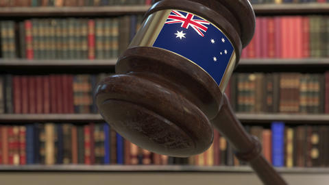 Flag of Australia on falling judges gavel in court. National justice or Live Action
