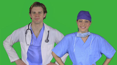 Professional medical couple with hands on hips (Green Key) Footage