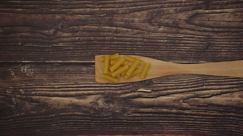 Wooden spoon and Tubetti on wooden background - Stop motion animation Animation