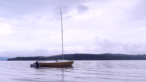 Boat anchored in calm bay. Touristic resort with nobody. Calm water level, idilic walk at shore Live Action