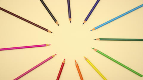 colorful pencils moving in circle on yellow background - Stop motion Animation