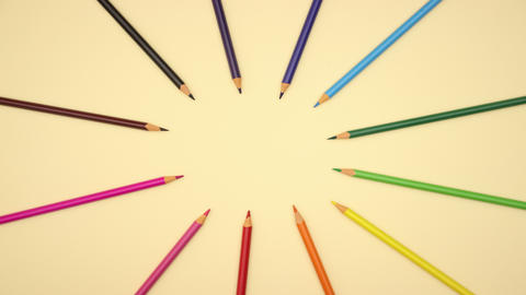colorful pencils moving on yellow background - Stop motion Animation