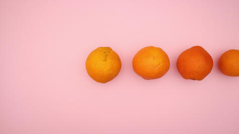 Oranges passing by on pink background - Stop motion animation video Animation