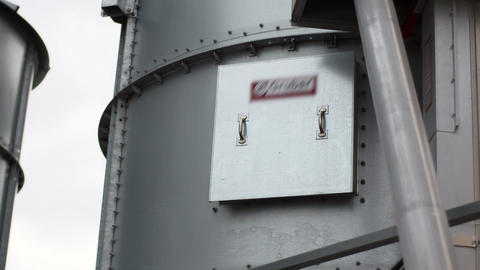 Part of factory equipment. Metal water tanks stand in open air Footage