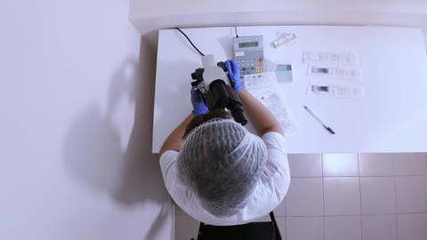Woman laboratory assistant in the workplace top view Footage