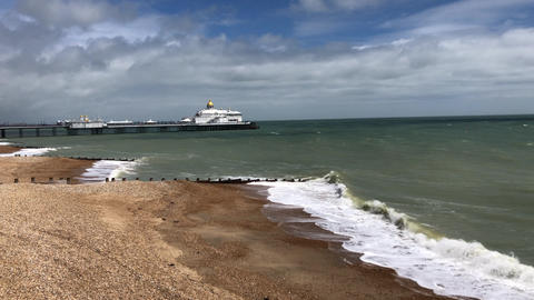 JSP-0829 Bournemouth Pier view from beach on cold windy sunny day Footage