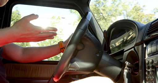 Person gesturing while driving steering wheel in car Footage