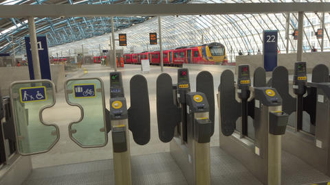 JSP-0888 Waterloo Train Station London, gates view to train son platform Live Action