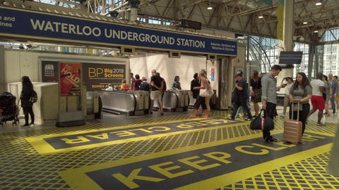 JSP-0883 Waterloo underground Train Station London entrance many people, sunny day Live Action