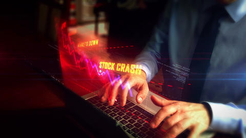 Man typing on keyboard with crisis chart hologram Live Action