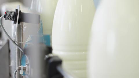 Factory process. Close up packing milk bottles. Label milk bottles Live Action