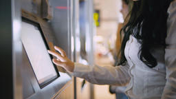 Woman Buying Ticket In Ticketing Machine On The Train Or Subway Station Live Action