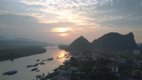 motion to high bridge over wide calm river against sunset Footage