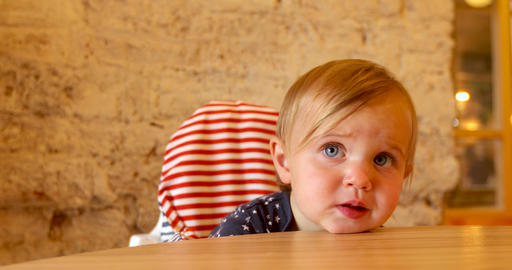 Little girl laid her head on table Footage