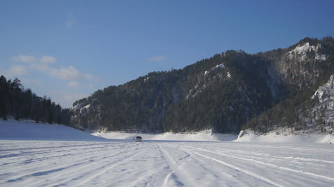 Car moves on the snowy road Stock Video Footage