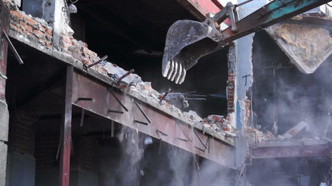 Demolishing a Building With Excavator Stock Video Footage