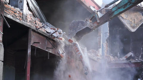 Demolishing A Building With Excavator stock footage