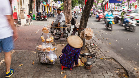 Timelapse of street vendor in Ho Chi Minh City Stock Video Footage