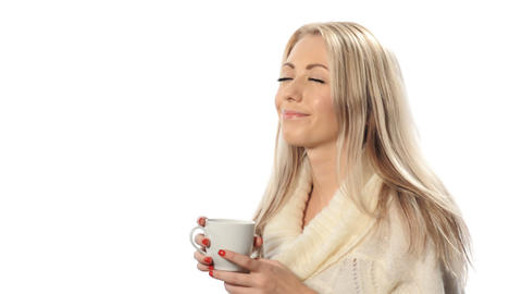 Young woman with long hair at drink tea from a cup Stock Video Footage