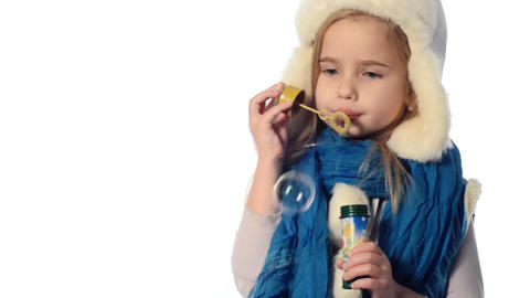 blonde little girl inflates bubbles Footage