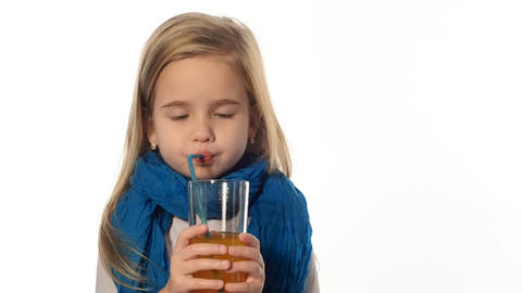 blond little girl drinking juice Footage