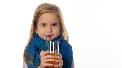 blond little girl drinking juice Stock Video Footage