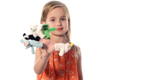 little girl plays with toys Footage