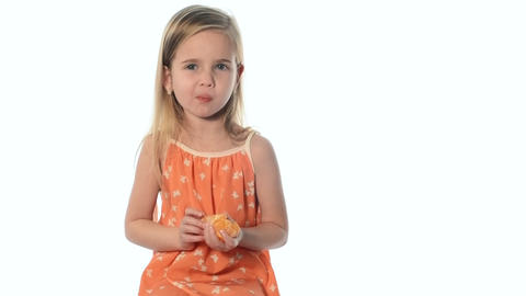 little girl eats tangerine Footage