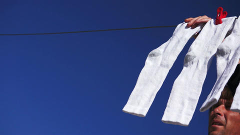 Male Hanging Socks to Dry Stock Video Footage