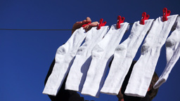 Male Hanging Socks to Dry Footage