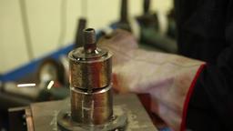 Man doing metalworking using a grinding wheel Footage