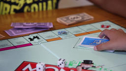 children playing monopoly Footage