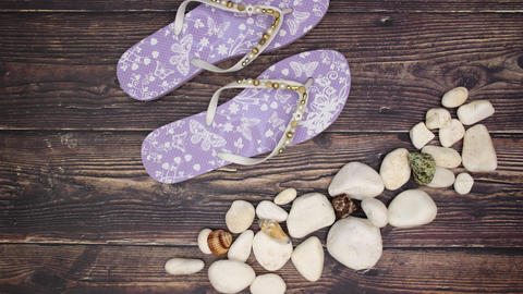 Stones and Slippers on wooden background - Stop motion Animation