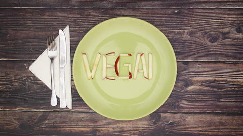 Vegan word on green dish - Stop motion Animation
