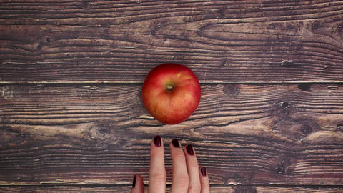 Woman take red apple from the table - Stop motion Animation