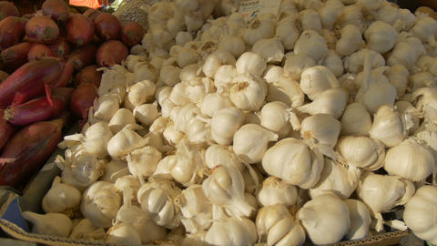 Piles of Organic Garlic for Sale Live Action